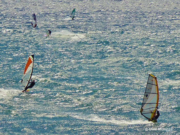 wind surfing on the santa cruz coast by Uwe Muegge